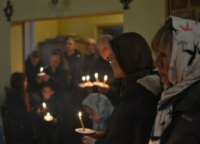 Parishioners pray before the Kursk-root icon.
