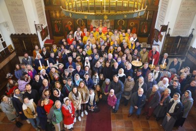 Faithful gather after the Divine Liturgy at the Memorial Church, Brussels, 2019