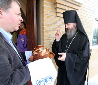 Bishop welcomed with bread and salt.
