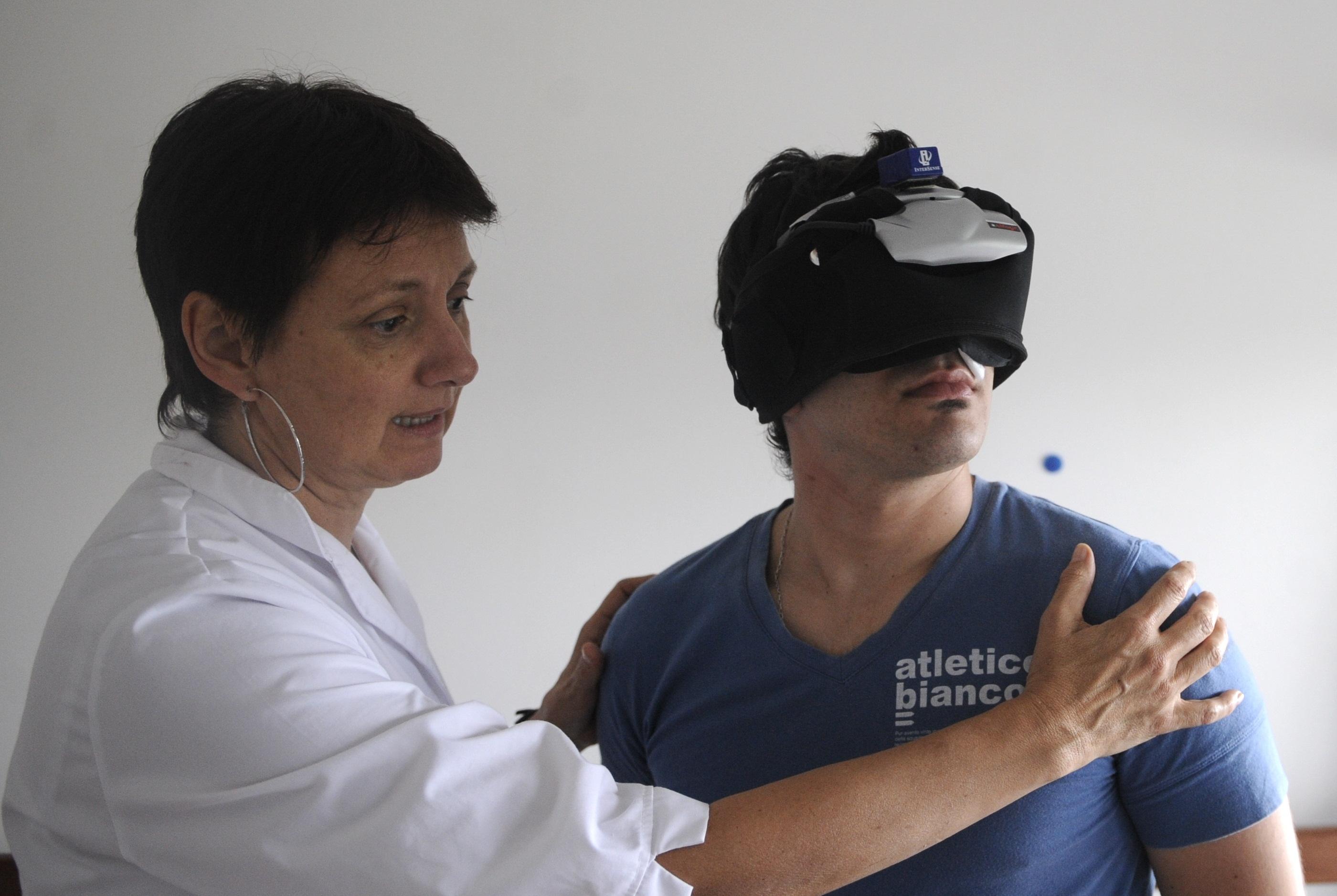 Physiotherapist Teresa Arocena (L) exerc