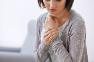 woman suffering from wrist pain
