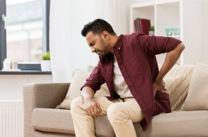 man suffering from severe back pain