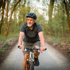 Senior man on his mountain bike outdoors