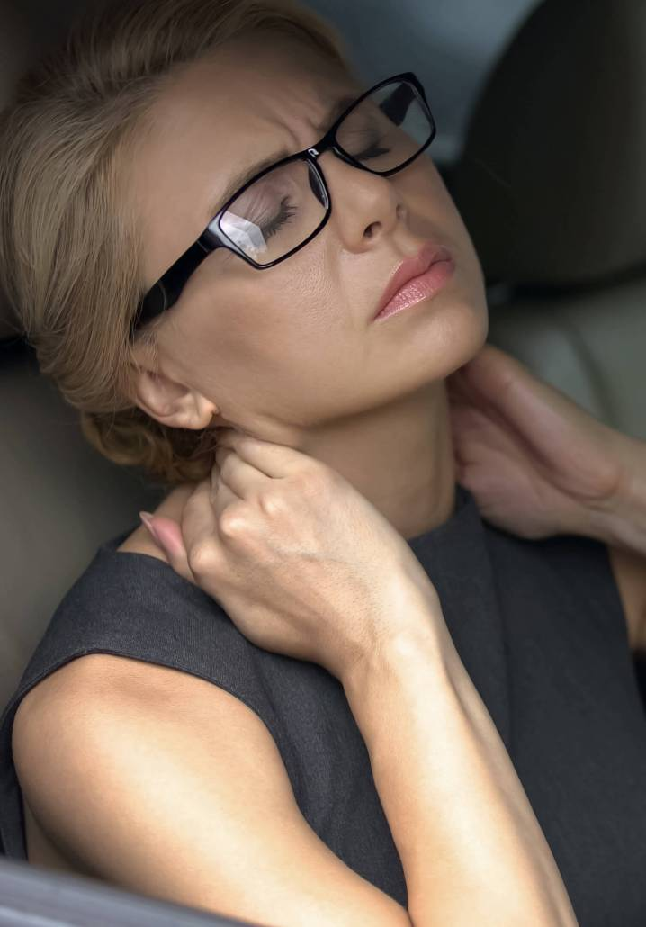 Tired businesswoman in car feeling strong neck pain, nerve inflammation