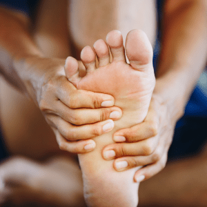 Person with Plantar Fasciitis in pain