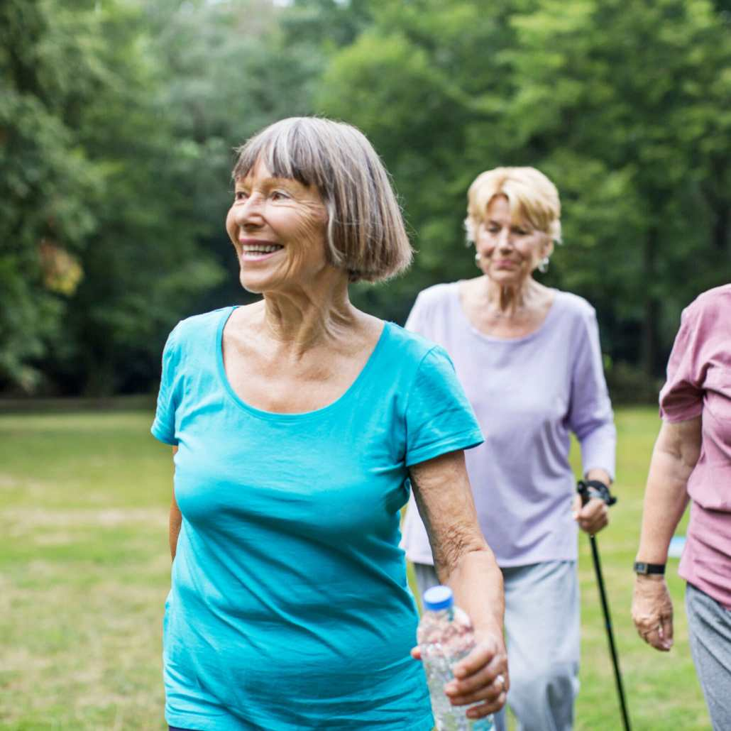 Healthy senior women walking in park