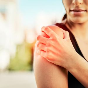 Woman suffering from rotator cuff tear