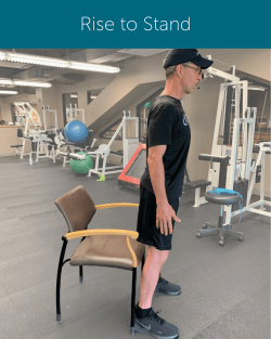Orthopedic Institute Spine Therapist demonstrates proper sit to stand form ending with rising to stand.