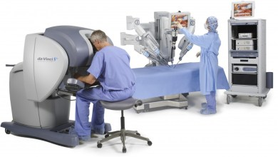Photo of Intuitive Surgical CEO on da Vinci Surgical System