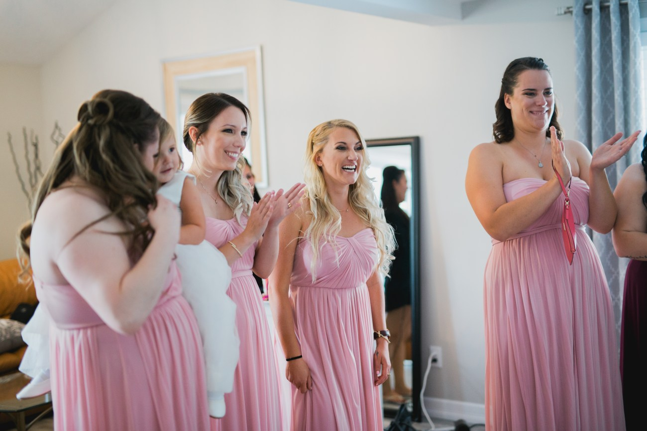 brides maids looking at bride for first time