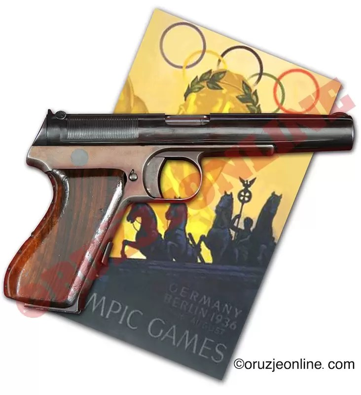 Yovanovitch 1930 .380 ACP caliber pistol and poster of the 1936 Berlin Olympic games.