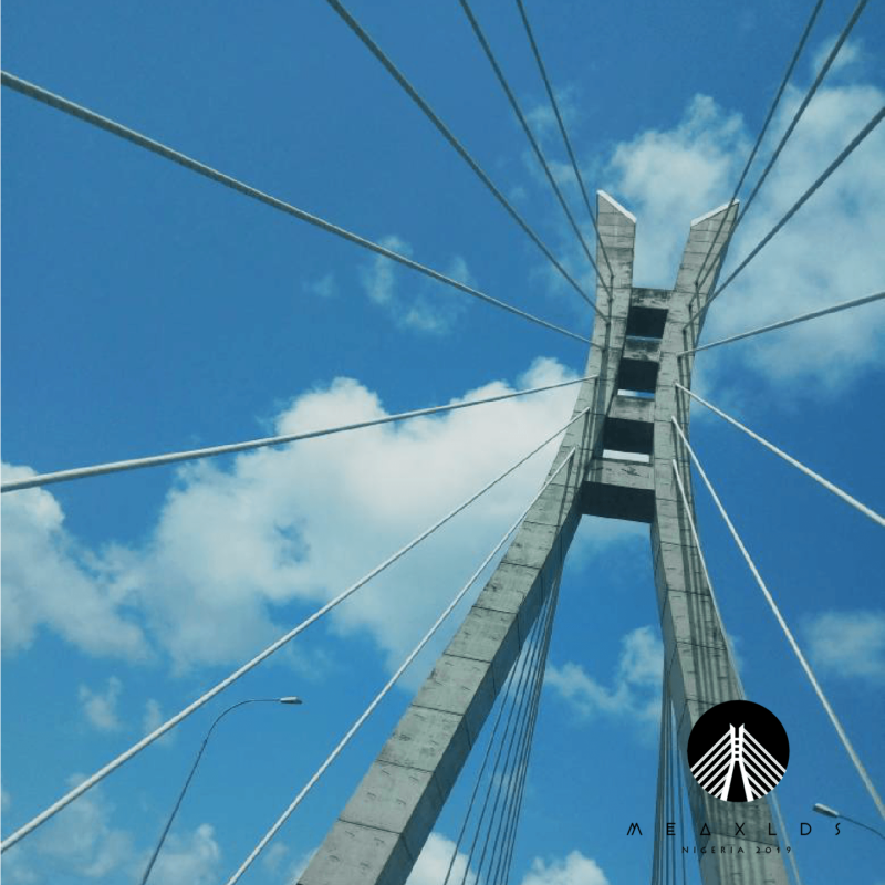 lekki ikoyi link bridge against a bright blue sky with the black meaxlds logo emblazoned in the bottom right corner