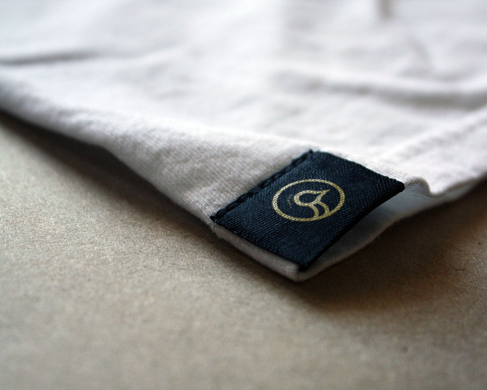 shirt with peacock head tag at the edge
