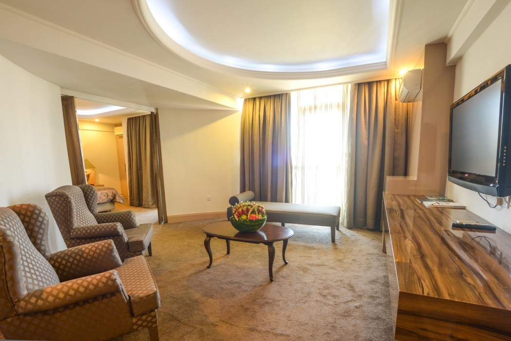 king suite living room with lcd tv