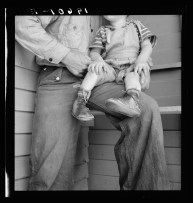 """Tulare County. In Farm Security Administration )FSA) camp for migratory workers. Baby with club feet wearing homemade splints inside shoe.""s"