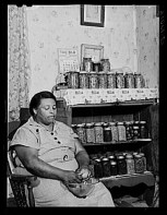 Jack Delano. Mrs Handy FSA Farm Security Administration client with vegetables she has just canned Scotland Maryland