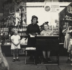 Lee Sievan (American, 1907-1990) Salvation Army Lassie in Front of a Woolworth Store, c. 1940