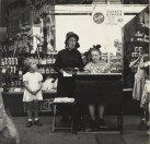 Lee Sievan. Salvation Army Lassie in Front of a Woolworth Store, c. 1940