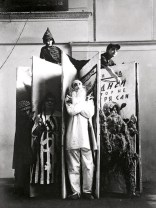 alexander-rodchenko-varvara-stepanovas-designs-for-the-performance-of-an-evening-of-the-book-with-the-protagonists-standing-in-front-1924
