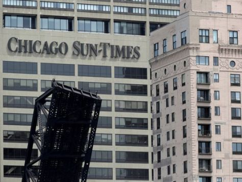 1369949375000-AP-Chicago-Sun-Times-Photographer-Layoffs-1305301731_4_3_rx404_c534x401