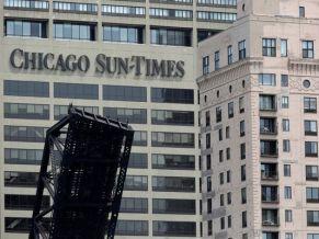 1369949375000-AP-Chicago-Sun-Times-Photographer-Layoffs-1305301731_4_3_rx404_c534x401