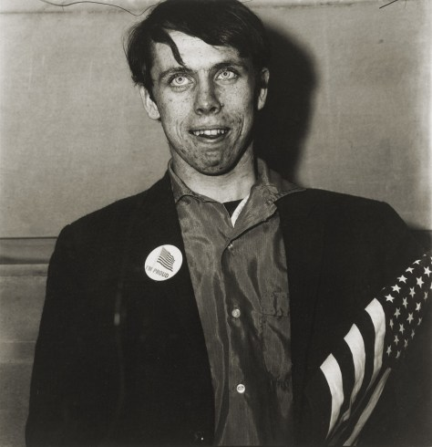 patriotic young man with flag, NY 1967