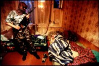 Putin's Russia - The Darkness of Russia June 2001 Volgograd, Russia Drug raid, the OMON squad is a special purpose police unit, militia-comando outfit. They wear military style uniforms and sometimes masks, blue flak jackets and carry machine pistols, AK-47's.