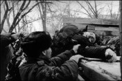 Chechnya, Grozny, soldiers loading dead bodies on truck, side view . January 1995.