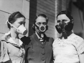 Three girls model Dust Bowl masks to be worn in areas where the amount of dust in the air causes breathing difficulties, circa 1935.