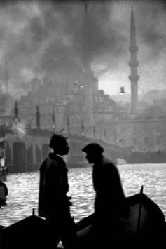 TURKEY. 1956. Boatmen in the Golden Horn, Old Galata Bridge and the New Mosque.