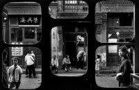 CHINA. 1965. A street in Beijing as seen from inside an antique dealer's shop.