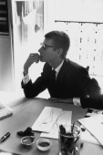 FRANCE. Paris. A portrait of Yves SAINT LAURENT in his office in 1964.