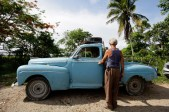 70-year-old Gilberto Ruiz stands beside his modified 1948 Ford in Havana June 18, 2012. Gilberto, who was unemployed, with a big family to support and his permit to use his car as a private-licensed taxi had expired, literally welded himself a new job and cut up his sedan turning it into a pick-up truck to work in the private transport bussiness. REUTERS/Desmond Boylan (CUBA)