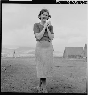 """""""Young migrant mother has just finished washing. Merrill FSA (Farm Security Administration) camp, Klamath County, Oregon."""" Dorothea Lange"""