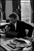 USA. Washington DC. 1961. President John F. KENNEDY looks at a model of PT 109, the patrol boat he skippered in Elliott Erwitt