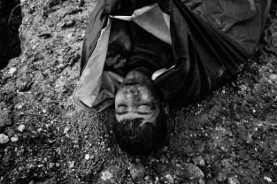 Bustan al-Qasr frontline neighborhood, April 5, 2013. Unknown bodies found in the Aleppo river are buried in a children playground under sniper fire