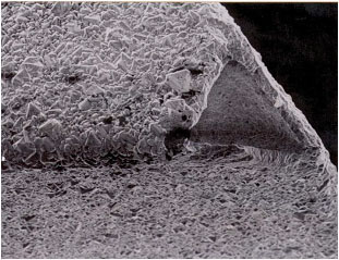 Diamond delamination (large grain size).