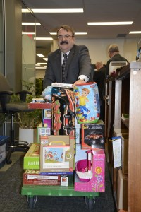 Councillor Bob Chapman wheels out a load of toys during last year's toys for tickets campaign. The city will once again be launching this initiative, with residents being able to pay off parking tickets levied between Nov. 28 and Dec.11 with toys rather than money.