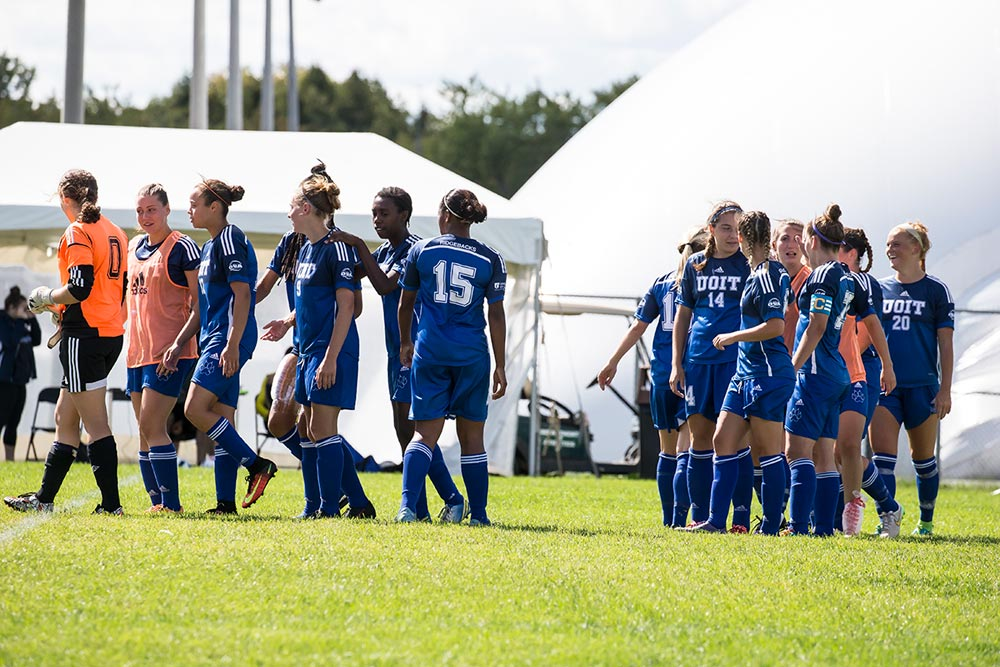 UOIT celebrates its victory over the RMC Paladins.