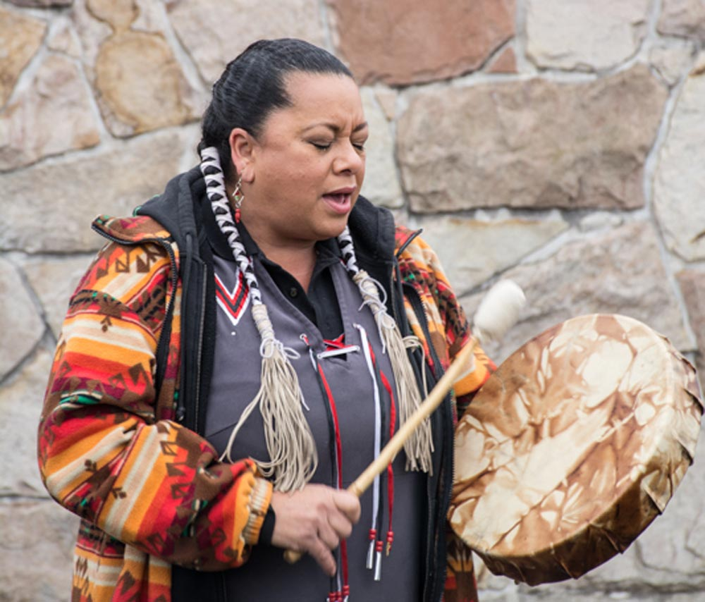 Kim Wheatley, an Anishinaabe Traditional Grandmother, offers a blessing to honour the traditional lands of the Mississaugas of Scugog Island First Nation during the groundbreaking ceremony for Durham College's Centre for Collaborative Education. The new $40-million facility is set to open its doors in 2018.