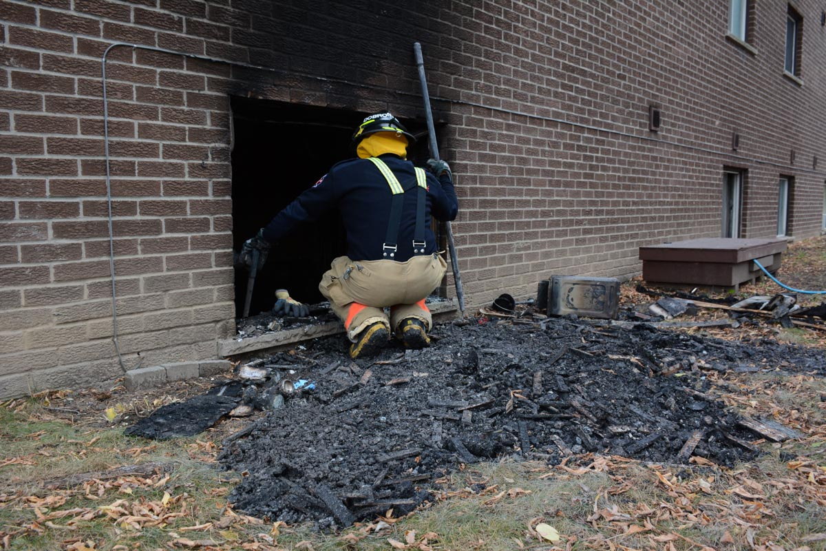 Nobody was hurt following an apartment fire on Sunday morning. While the blaze had originally been deemed suspicious, a subsequent investigation has determined that it was not.