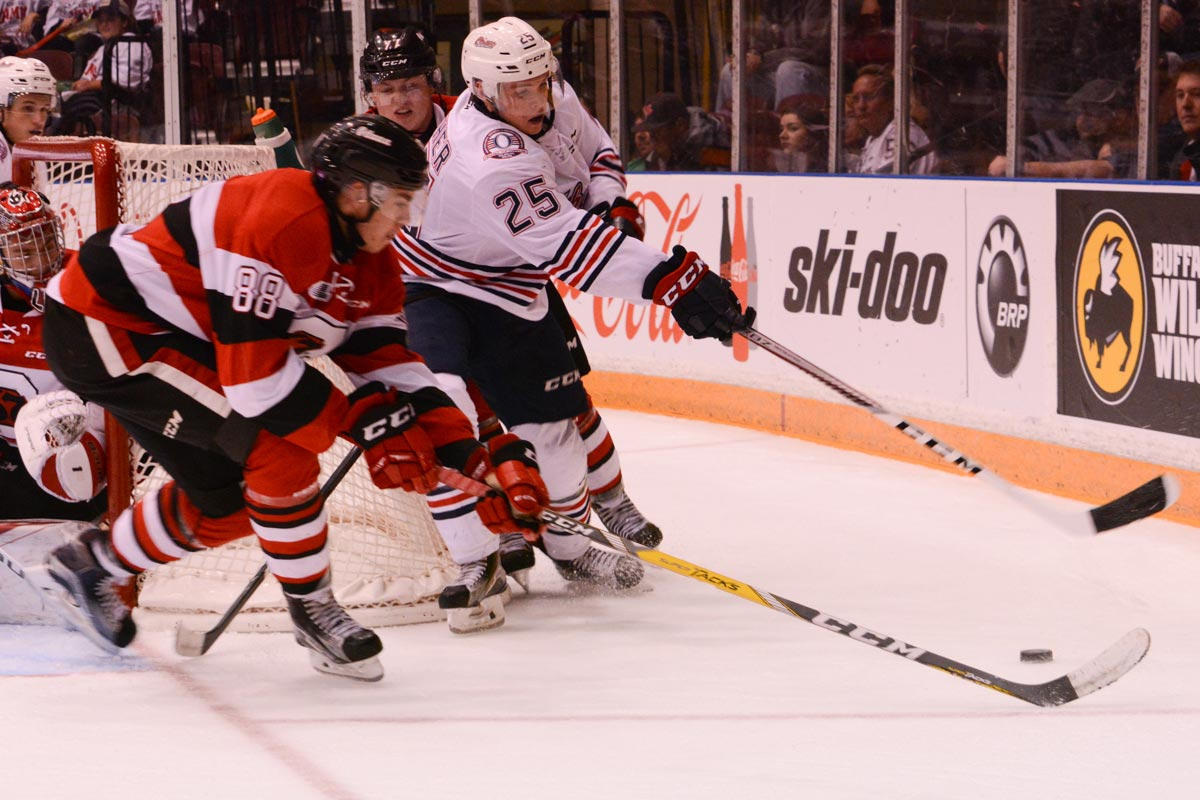 Oshawa's Kenny Heuther battles for the puck behind the Ottawa 67s net against defender Kevin Bahl on Nov. 6. The Generals would go on to win the game 6-0 to regain their top spot in the OHL Eastern Conference.