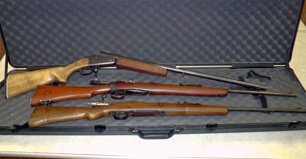 Three people are facing charges after three firearms, pictured here, and drugs were seized from an Oshawa home.