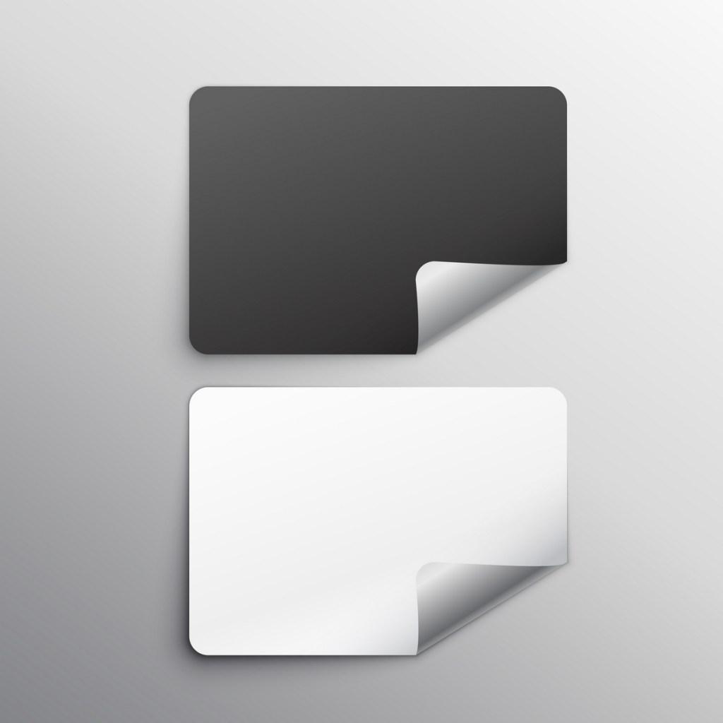 회색배경에 검정색스티커가 위에 하얀색 스티커가 아래 붙어있으며 검정색스티커와 하얀색스티커의 오른쪽 아래 모서리 부분이 살짝 뜯어져있는 일러스트 이미지이다.