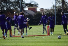 Players participate in soccer tennis to warm up during training prior to Orlando City SC's media day on Friday, February 26, 2016. (Victor Ng / Orlando Soccer Journal)