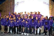 Players pose for the media after the announcement of the new Orlando City SC training facility in Lake Nona on Jan. 29, 2016. (Rosie Reitze / Orlando Soccer Journal).