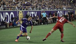 Adrian Winter (left) makes a move to the inside of the pitch as Arturo Alvarez (right) tries to stop him in a match between Orlando City and the Chicago Fire in the Orlando Citrus Bowl on Friday, March 11, 2016. The match concluded in a 1-1 draw. (Victor Ng / Orlando Soccer Journal)