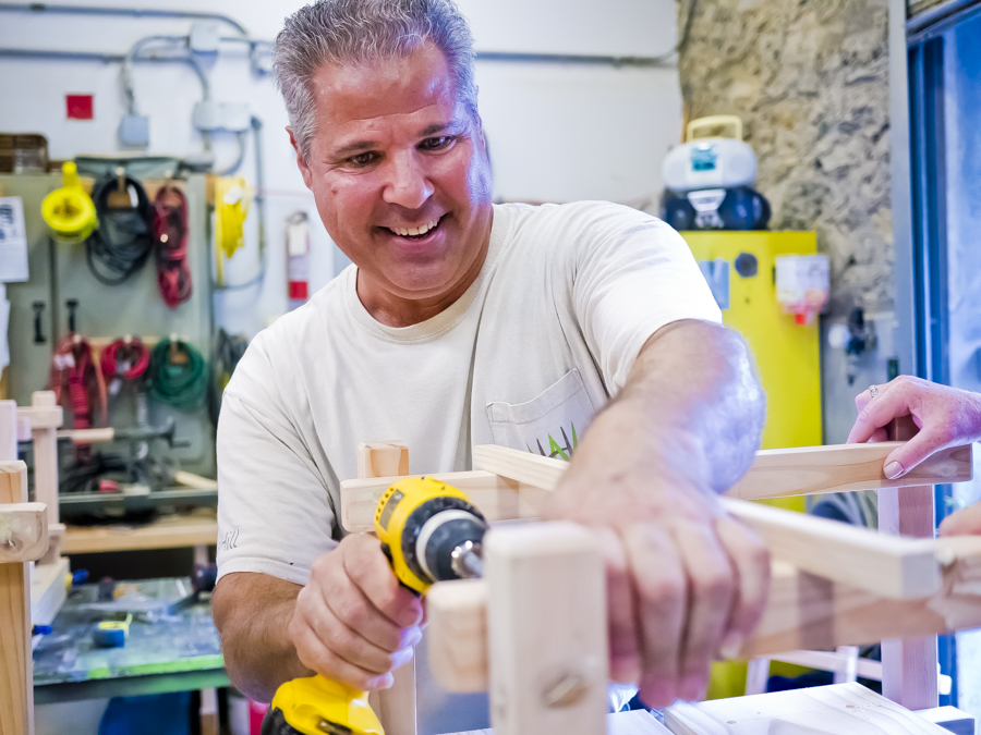 FRANK PERRONE, director of facilities of capital projects at Wave Hill, shows his students how to properly construct outdoor patio tables at a seasonal Wave Hill woodworking workshop on Aug. 3.