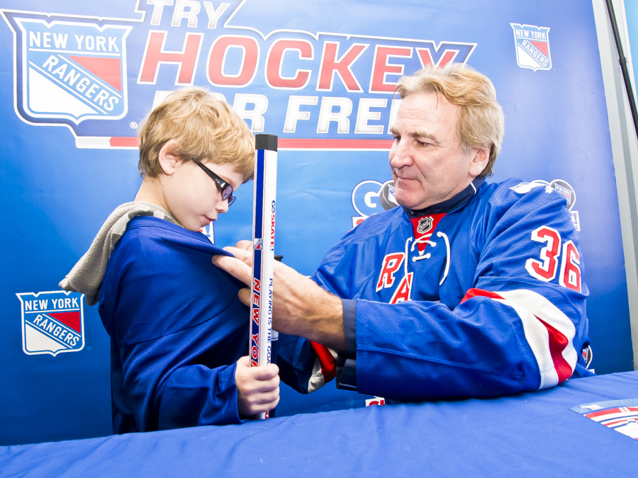 JONAH GONZALEZ, 6, gets his jersey signed by NHL Hall of Fame Glenn Anderson at the NY Rangers Try Hockey For Free, Future Rangers event at Van Cortlandt Park ice rink.