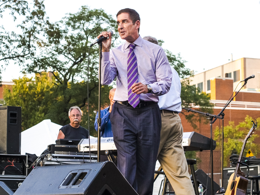 TATE SENATOR JEFF KLEIN opens the 2014 Summertime Series Symphonies concert with Tony Orlando on stage at Seton Park on Aug. 28.